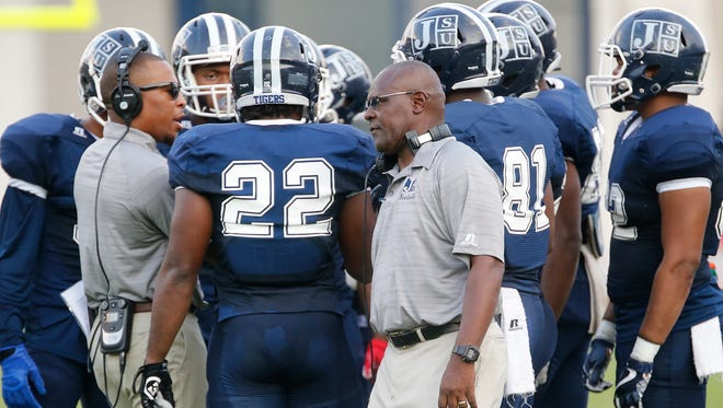 Jackson State players and coaches confer in between plays during the first half of the Tigers' game against Arkansas-Pine Bluff on Saturday in Jackson.