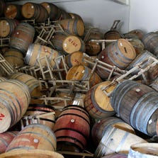 This Aug. 24, 2014, file photo shows barrels filled with Cabernet Sauvignon that toppled on one another following an earthquake at the B.R. Cohn Winery barrel storage facility in Napa, Calif.