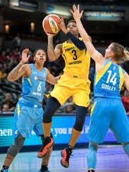 Indiana Fever guard Tiffany Mitchell (3) drives by