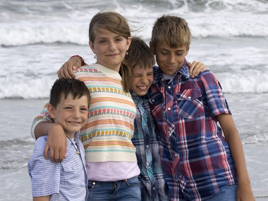 Kennis Cady with brothers, Merritt, Solas and Aidan while on a family vacation in Stone Harbor, New Jersey, in 2014.