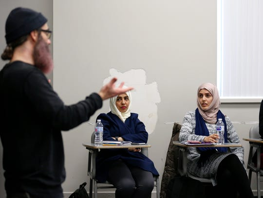Students from Saudi Arabia participate in a class discussion