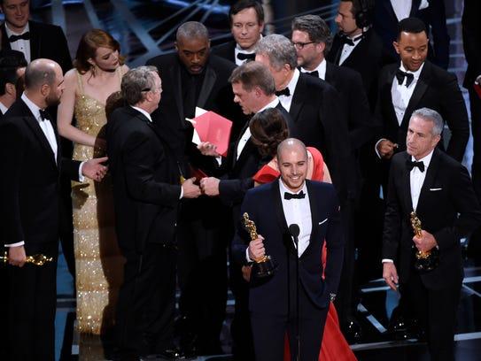 As 'La La Land' filmmakers accept the award, PricewaterhouseCoopers'