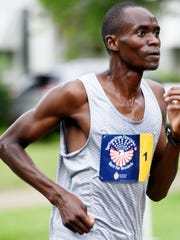 Alfred Kiplagat wore the No. 1 bib and celebrated a