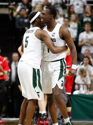 Michigan State guard Joshua Langford (1) celebrates with guard Cassius Winston (5) during the second half of MSU's 77-57 win over Youngstown State Tuesday at Breslin Center.