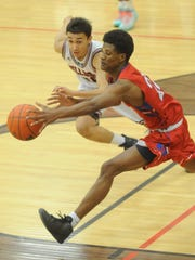 Cooper's Elijah Brown, right, fights a Plainview player