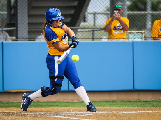 Angelo State's Courtney Barnhill swings to hit the ball against Texas A&M-Commerce during the Division II South Central Super Regional Friday, May 18, 2018, at Mayer Field.