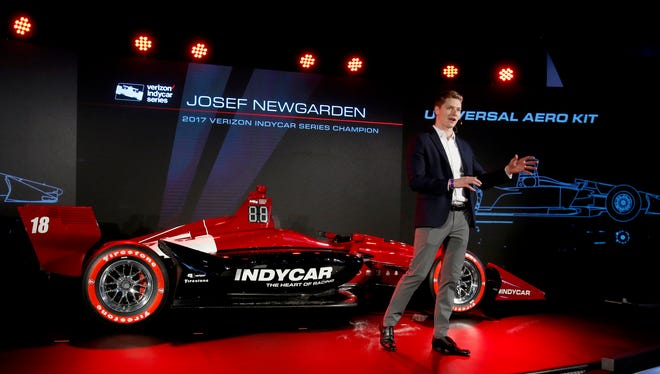 Josef Newgarden, the 2017 IndyCar series champion, talks about the redesigned 2018 IndyCar at the North American International Auto Show at Cobo Center in Detroit on Tuesday.