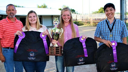 The State 4-H Livestock Judging Contest was held July 24 at the Lodi Agricultural Fairgrounds in Lodi, Wisconsin. Pictured (from left) is the first-place senior team from Manitowoc: Coach Rob Ash, Megan Greif, Vanessa Roberts and Ambrose Wiering.