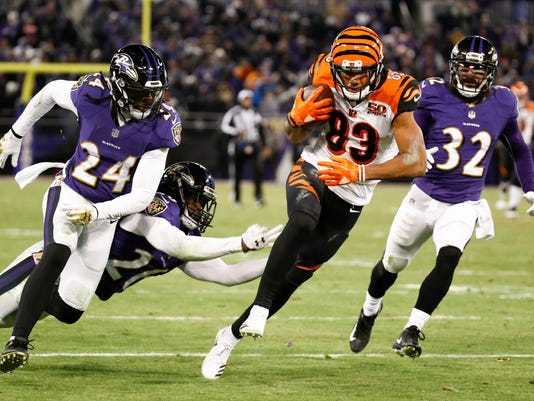 Cincinnati Bengals wide receiver Tyler Boyd (83) carries the ball toward the end zone for a touchdown as Baltimore Ravens cornerback Brandon Carr (24), cornerback Maurice Canady (26) and free safety Eric Weddle (32) chase him during the second half of an NFL football game in Baltimore, Sunday, Dec 31, 2017. (AP Photo/Patrick Semansky)