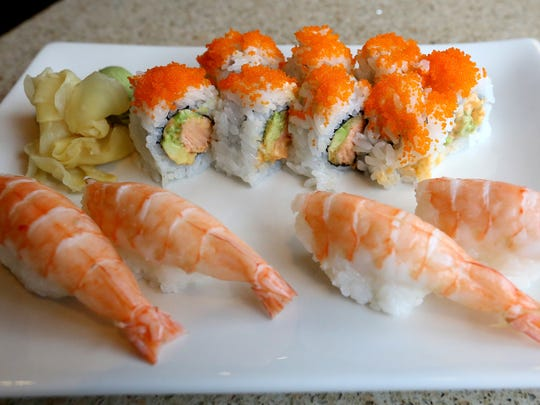 A Spicy Salmon Tempura Roll and Cooked Shrimp Nigiri are served at Momiji in Salem.