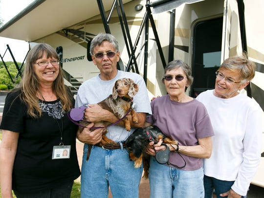 (Left to right) Sonya Pulvers of Marion County Dog Services, John Sinnar with Herbie, Dorothy Sinnar with Hilda and Diane Young of Salem Dogs at the Hee Hee Illahee RV Resort on Wednesday, June 1, 2016. Pulvers helped place the two dogs in foster care with Diane Young, where they stayed for a month before being adopted by the Sinnars.