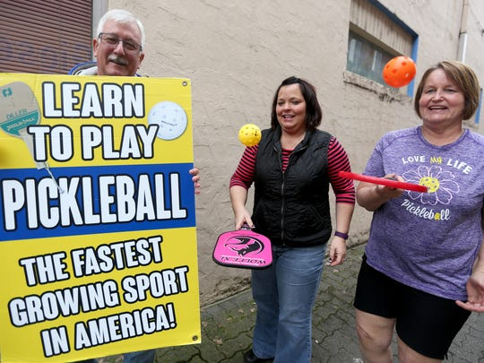 Al Bushey, from left, Michelle McDermeit and Cindy Bushey hope people looking for a fun sport will join them for pickleball games.