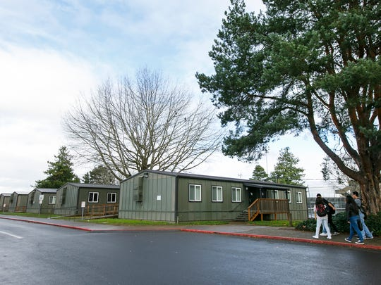 Portable classrooms at McKay High School on Monday, Nov. 28, 2016. The school is one of the most overcrowded schools in the district; it was built to accommodate about 1,750 students but this year's enrollment is close to 2,400. Its classrooms are smaller by square footage than any other Salem-Keizer district school, and it is the only one without an auxiliary gym or turf field.