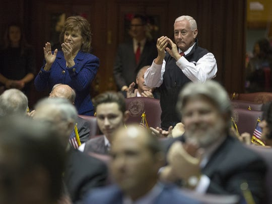 At right, Gregory Pence cheers as the unanimous vote for his brother, Vice President-Elect Michael Pence, is announced at the meeting of Indiana's 11 presidential electors to cast votes for President and Vice President of the United States, at the statehouse, Indianapolis, Monday, Dec. 19, 2016.