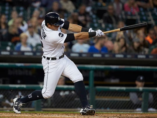 Tigers leftfielder Mikie Mahtook (15) hits a two-run
