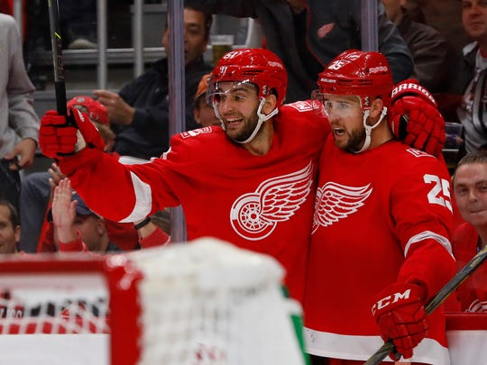 Red Wings defenseman Mike Green (25) is congratulated by center Frans Nielsen (51) after scoring in the second period of the Red Wings' 3-2 loss to the Lightning on Monday, Oct. 16, 2017, at Little Caesars Arena.