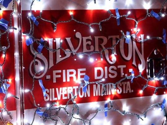 A Silverton Fire District engine is covered in lights during the Silverton Tree Lighting Ceremony at Town Square Park in Silverton Dec. 1, 2017.