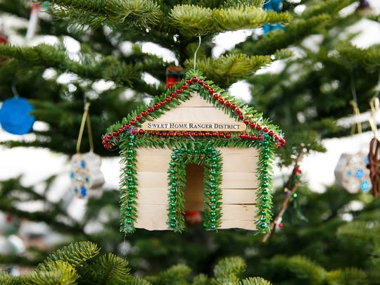 Handmade ornaments made by the U.S. Forest Service hang on Christmas trees as it is announced that Oregon has been selected to provide the 2018 United States Capitol Christmas Tree on Friday, Jan. 19, 2018, in Sweet Home, Oregon. Over 10,000 ornaments, handmade by Oregonians, will also be sent to the Capitol.