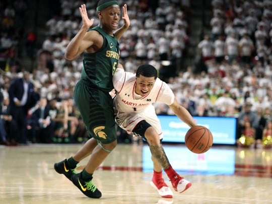 Jan 28, 2018; College Park, MD, USA; Maryland guard Anthony Cowan drives to the basket against Michigan State guard Cassius Winston at XFINITY Center.
