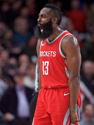 Houston Rockets guard James Harden reacts after defeating the Portland Trail Blazers 115-111 at the Moda Center.