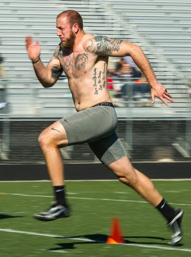 Southern Utah University tight end Steve Wroblewski runs the 40-yard dash during the SUU Pro Day at Desert Hills High School in St. George Tuesday, March 27, 2018. Scouts from 14 National Football League teams watched as players from SUU and Dixie State University performed the trials.