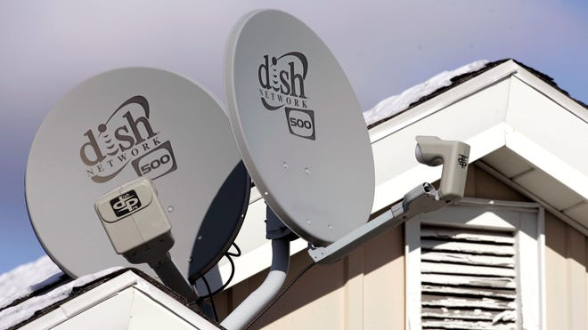 Dish Network Corp. satellite dishes are attached to this home in Buffalo, N.Y.  Dish Network and Disney reached a landmark deal  March 4  that envisions the day when Dish will offer a Netflix-like TV service to people who'd rather stream TV over the Internet than put a satellite receiver on their roof.