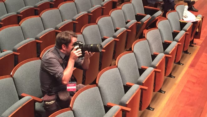 Tennessean photographer Sam Simpkins takes some test shots before the start of the June 18 debate in the Massey Performing Arts Center at Belmont University.