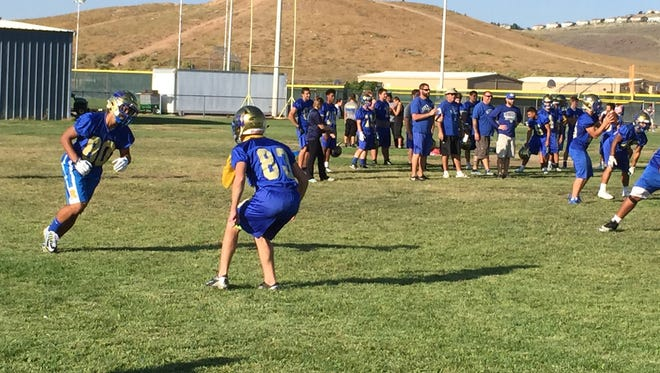 Reed junior Michael Spivack, left (No. 80) practices at the school on Monday.