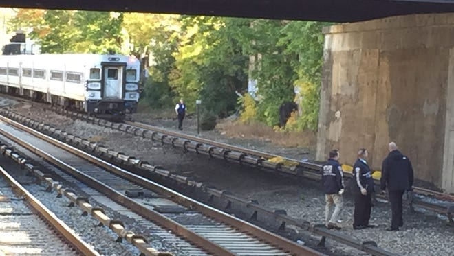 Investigators on the tracks in Tuckahoe Friday morning after a man was struck by a train near the station.