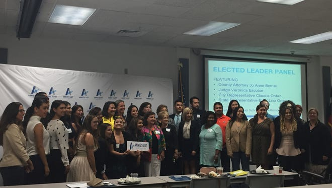 Participants pose for photos with El Paso elected officials at an Annie's List event Saturday in El Paso. The event focused on encouraging and preparing women to run for public office.