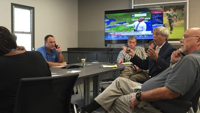 Leon County Superintendent Jackie Pons, second from right, discusses the decision to close area schools as Tropical Storm Hermine approaches.