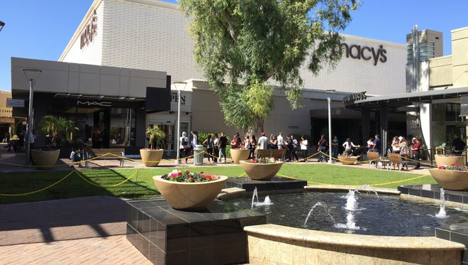 The line outside the MAC store at Biltmore Fashion Park moments before the store sold out of its Selena collection on Oct. 6, 2016, in Phoenix.