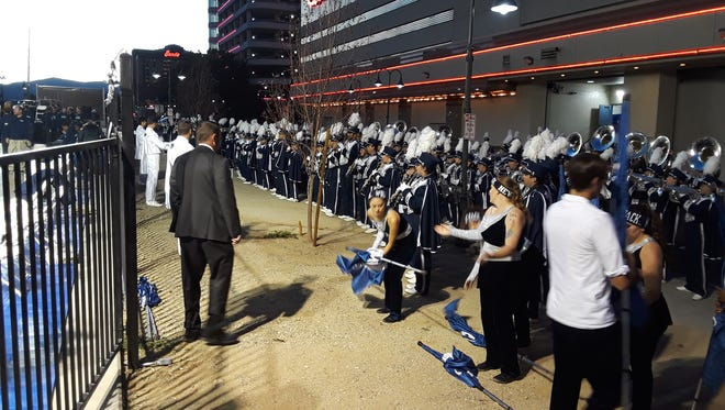 The Wolf Pack marching band warms up before the Arch Madness event downtown Saturday night.