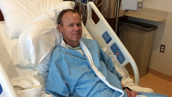 Bret Carroll of Grand Chute undergoes treatment in a clinical trial of a new cancer treatment developed by Froedtert Hospital & the Medical College of Wisconsin. He is the first in the nation to receive this treatment, which sent his cancer into remission.