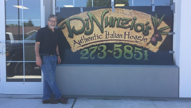 Dave DiNunzio stands outside of his new sandwich shop, DiNunzio's Authentic Italian Hoagie, which opens at the Poplar Commons strip mall on Tuesday, June 19.