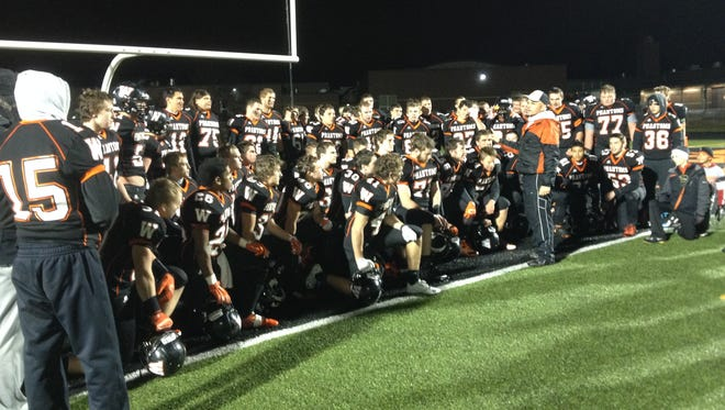 West De Pere coach Jack Batten talks to his team following another dominant victory.