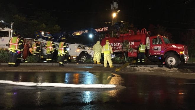 A red tanker belonging to Castlton Environmental Contractors of Nanuet flipped Tuesday, Oct. 21, 2014, near the Sears Automotive Center and across from the Nanuet Diner on Rt. 59.