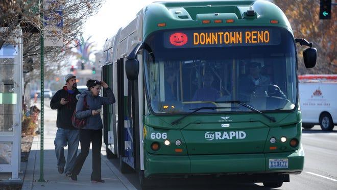 Passengers board an RTC RAPID bus on Virginia Street.