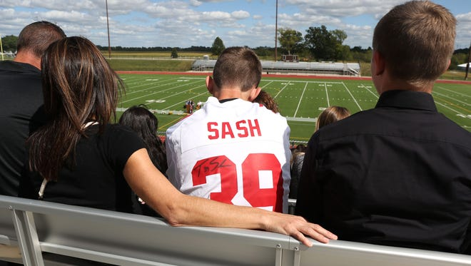 Friends and family paid respects to former Hawkeye and New York Giant football player Tyler Sash during a memorial service at the Lacey Recreation Complex on Friday.