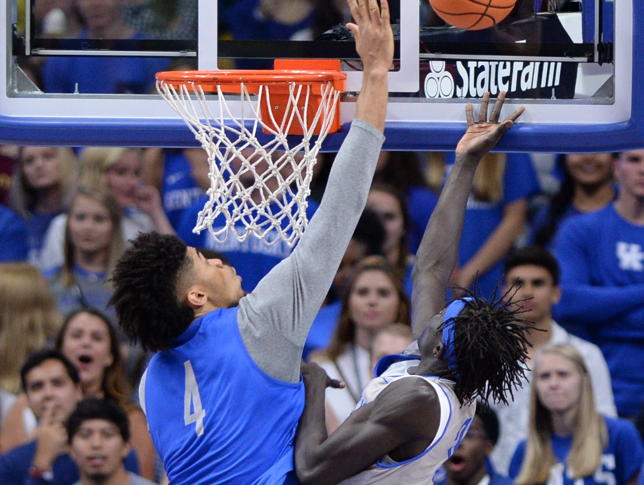 UK forward Nick Richards blocks the ball during the University of Kentucky mens basketball Blue-White scrimmage in Lexington, Kentucky, on Friday, Oct. 20, 2017.