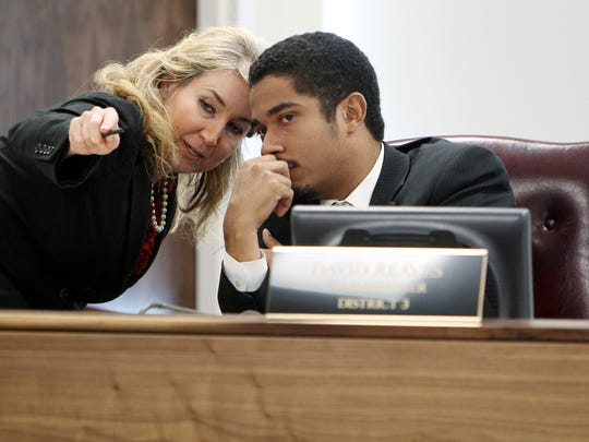October 22, 2014 - Commissioners Heidi Shafer (left) and Justin Ford have a side conversation during the General Government Committee at the Vasco A. Smith, Jr. Administration Building.