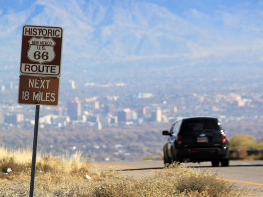 A car travels down historic Route 66 toward Albuquerque, N.M. in November 2014.