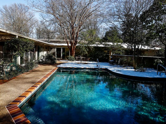 A saltwater pool is a feature of the home at 355 Waring Road, a-five bedroom, one-story midcentury home with a spacious formal living room and a banquet-size dining room.