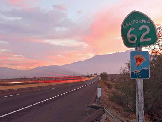 The sun sets on traffic traveling on Highway 62 towards Mt. San Jacinto just west of Desert Hot Springs on Tuesday, November 11, 2014.