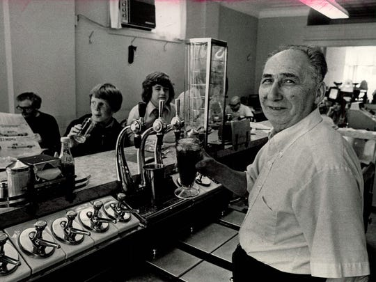 """Louis """"Louie"""" Throumoulos, seen in this 1975 photo at his business, Louie's Sweet Shoppe, served generations of customers."""
