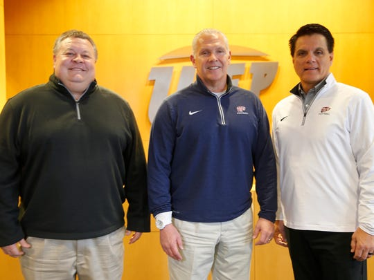 UTEP football coaches defensive coordinator Mike Cox, head coach Dana Dimel and offensive coordinator Mike Canales pose for a photo together after addressing the media Thursday afternoon at the Larry Durham Center.
