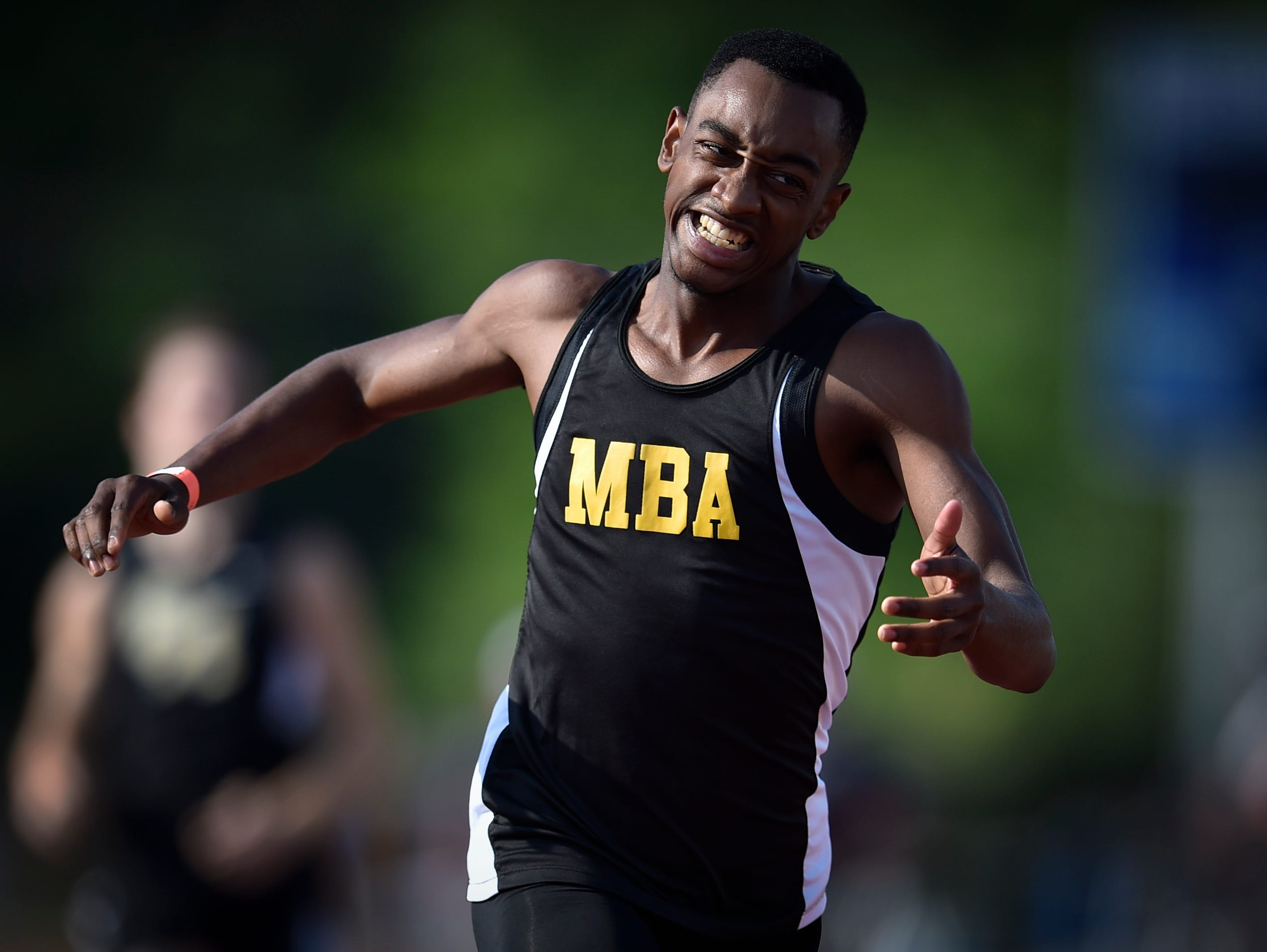 Memphis Business Academy's Kobey Hill reacts as he wins in the A-AA 400m Dash during the Spring Fling boys state track meet at MTSU's Dean Hayes Track and Field Stadium, Friday, May 27, 2016, in Murfreesboro, Tenn.