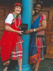 Sally Potts of Henderson with her friend Praises Mhlonga