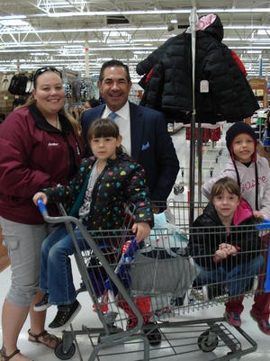 Bell School instructional coach Amber Abbott, from left, April Perkins, Michael Herrera, Leanne Perkins and Kya Temple shop for warm winter wear during the annual Coats for Kids event last week in Deming.
