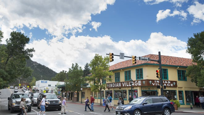 People walk down Elkhorn Avenue in Estes Park on September 17. The town is adding some new restaurants as it gears up for the summer tourism season.